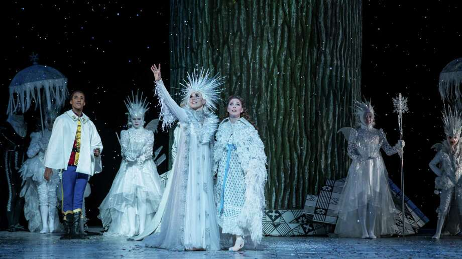 "The Snow Queen of Stanton Welch's ""The Nutcracker"" also performs as Mrs. Stahlbaum, Clara's Mother. Jessica Collado, seen here with Melody Mennite (Clara), Harper Watters (Nutcracker Prince) and other artists of Houston Ballet, exudes a generous spirit in the role. Photo: Amitava Sarkar / Houston Ballet / 2017"