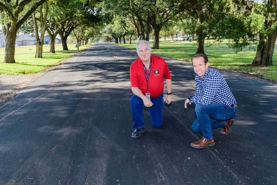 Friendswood Public Works Director Patrick Donart and project coordinator George Cherepes show improvements to East Viejo Road through a $2 million city of Friendswood project to repair neighborhood streets.