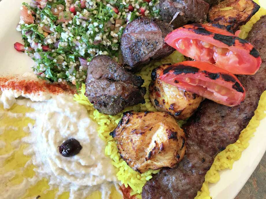 Mixed grill plate with cubes of lamb, chicken and a kebab made from a blend of beef and lamb with sides of tabbouleh and baba ghanoush at Babil Cafe. Photo: Paul Stephen /Staff