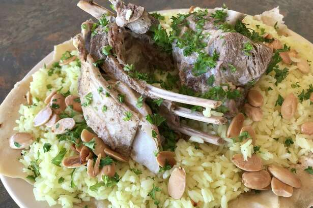 Mansaf, a dish of stewed lamb, rice and fried almonds, is the Friday special at Babil Cafe.