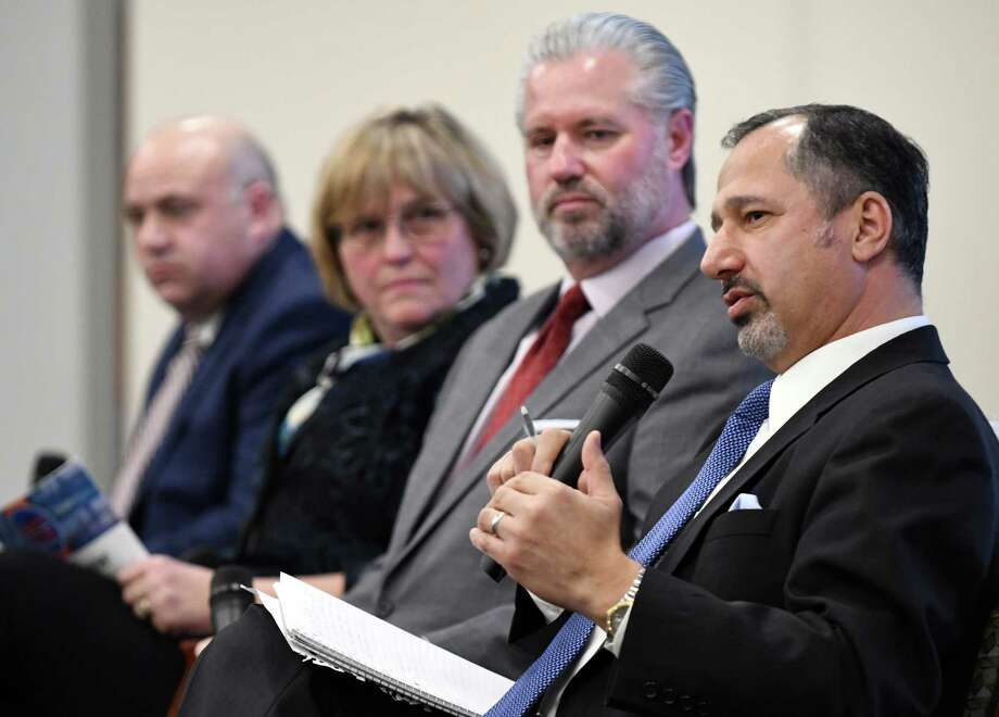 Michael Shamma, former chief engineer for the New York State Thruway Authority, right, speaks during a forum on the rebuilding needs of the NYS Thruway on Monday, Nov. 26, 2018, in Colonie, N.Y. Joining him are; Michael Fleischer former Thruway Authority executive director, left, Maria Lehman, former Thruway Authority chief operating officer and acting executive director, and Thomas Madison former Thruway Authority executive director. (Will Waldron/Times Union) Photo: Will Waldron, Albany Times Union
