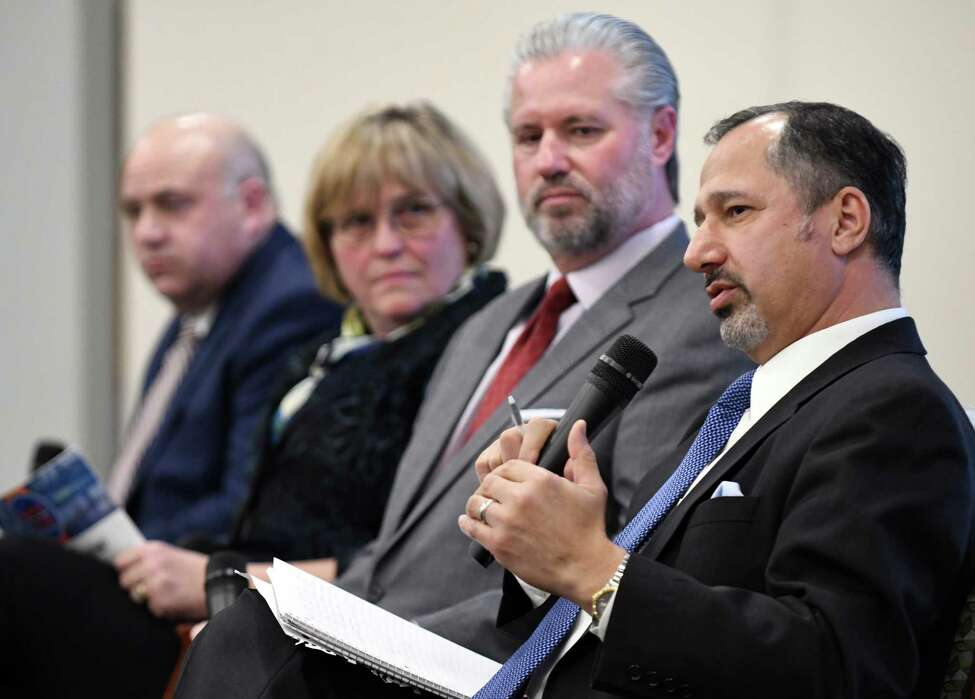 Michael Shamma, former chief engineer for the New York State Thruway Authority, right, speaks during a forum on the rebuilding needs of the NYS Thruway on Monday, Nov. 26, 2018, in Colonie, N.Y. Joining him are; Michael Fleischer former Thruway Authority executive director, left, Maria Lehman, former Thruway Authority chief operating officer and acting executive director, and Thomas Madison former Thruway Authority executive director. (Will Waldron/Times Union)