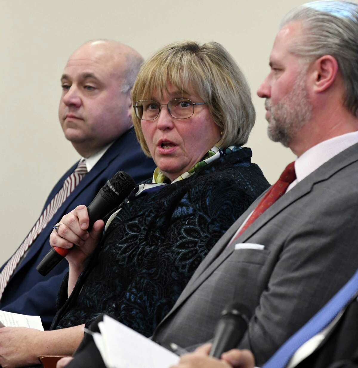Maria Lehman, former chief operating officer and acting executive director for the New York State Thruway Authority, center, speaks during a forum on the rebuilding needs of the NYS Thruway on Monday, Nov. 26, 2018, in Colonie, N.Y. Joining her are; Michael Fleischer former Thruway authority executive director, left, and Thomas Madison former Thruway Authority executive director, right. (Will Waldron/Times Union)