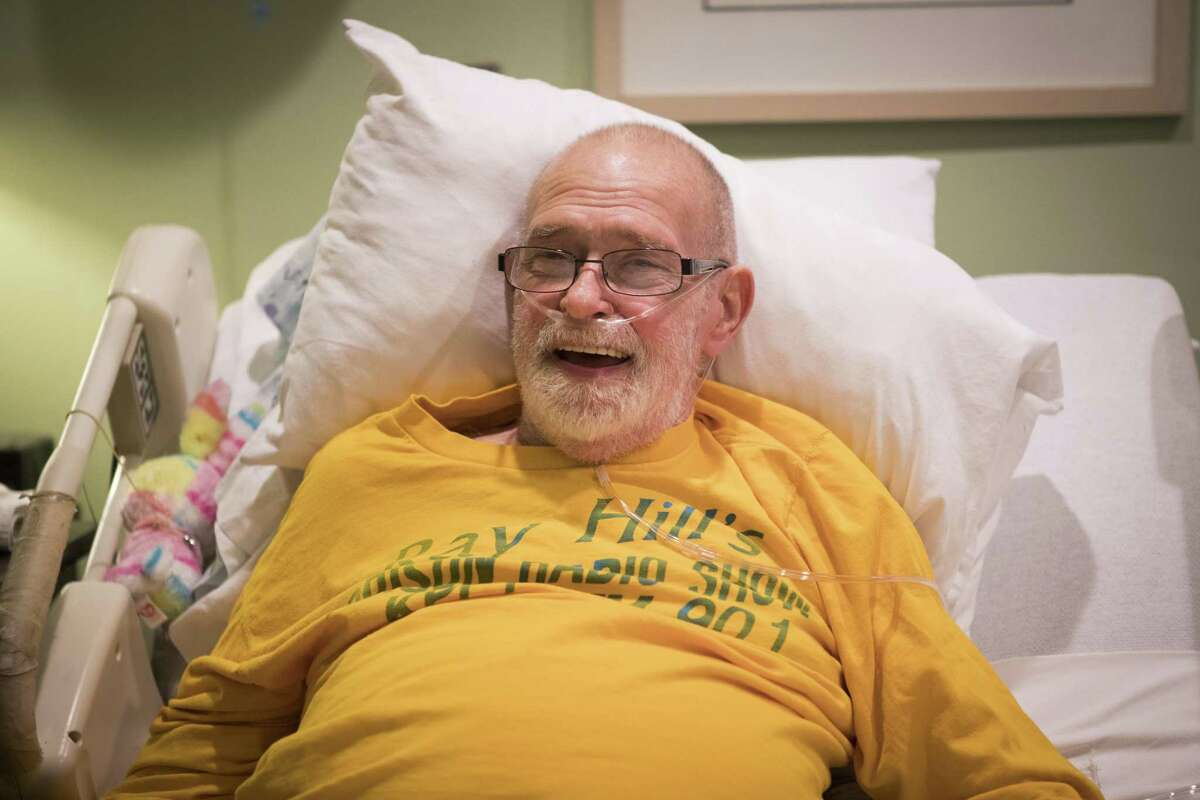 Ray Hill smiles while telling stories about his life from a hospice bed in the Omega House hospice, Saturday, Nov. 3, 2018, in Houston. Hill is a renowned gay activist and prison radio host.