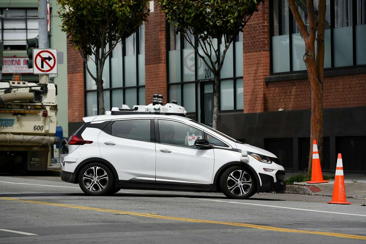 A Cruise Automation autonomous car pulls into the company's garage in San Francisco, Calif., Friday March 30, 2018.