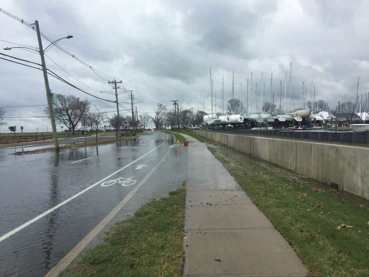Water from a high tide covers the road near Calf Pasture Beach in Norwalk on Monday, Nov. 26, 2018. The National Weather Service has posted a Coastal Flood Warning for southern Fairfield and New Haven counties from noon to 3 p.m. Monday and from midnight to 4 a.m. Tuesday.