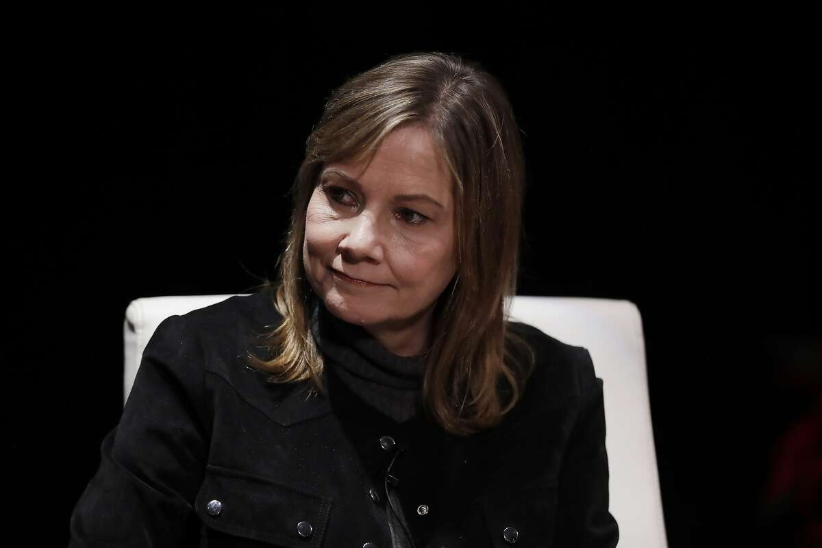 FILE- In this Dec. 11, 2017, file photo General Motors Chairman and CEO, Mary Barra, is interviewed by Cox Automotive's Michelle Krebs during an Automotive Press Association event in Detroit. GM announced Monday, Nov. 26, 2018, that it will lay off thousands of factory and white-collar workers in North America and put five plants up for possible closure as it restructures to cut costs and focus more on autonomous and electric vehicles. GM doesn't foresee an economic downturn and is making the cuts