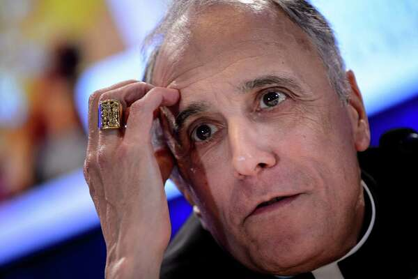 Galveston-Houston Cardinal Daniel DiNardo, president of the USCCB General Assembly, listens during a press conference at the annual U.S. Conference of Catholic Bishops on Nov. 12, 2018 in Baltimore, Md.