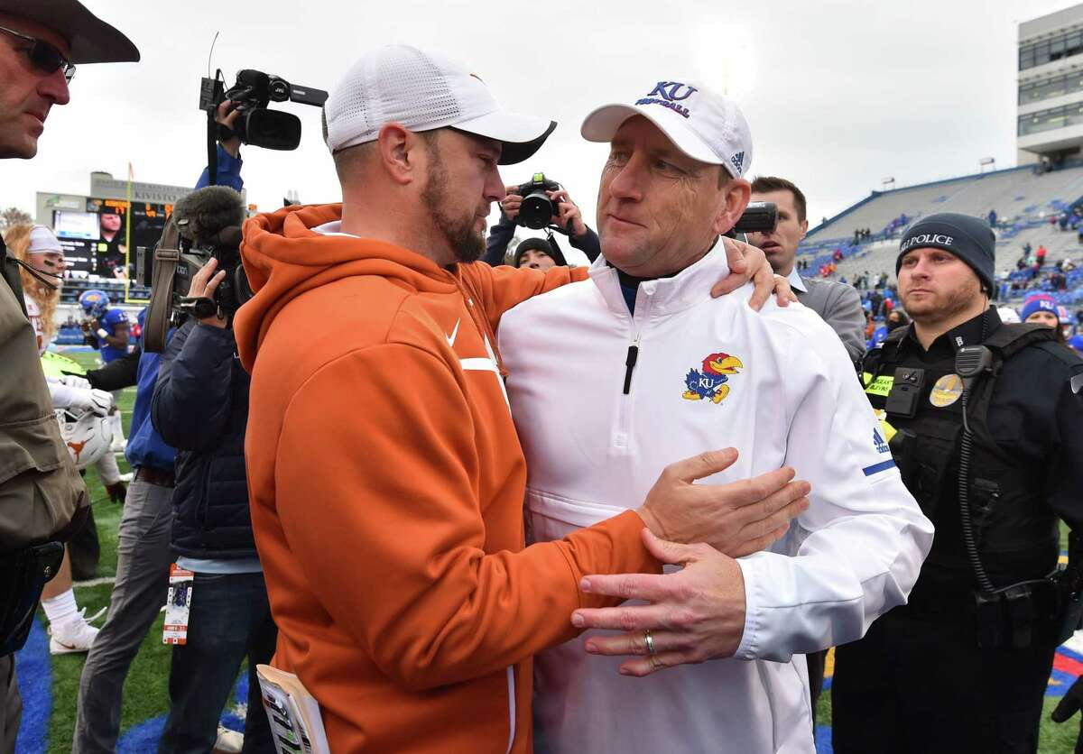 LAWRENCE, KANSAS - NOVEMBER 23: Head coach Tom Herman of the Texas Longhorns and head coach David Beaty of the Kansas Jayhawks greet each other after their game at Memorial Stadium on November 23, 2018 in Lawrence, Kansas. Texas won 24-17.