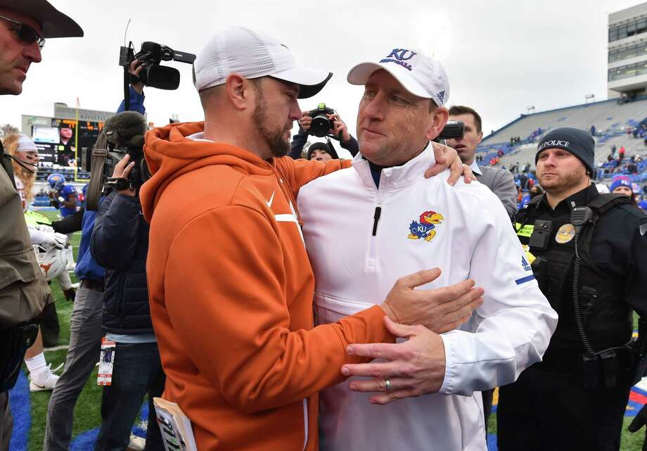 Former Kansas coach David Beaty, right, will assist old friend Tom Herman and Texas as it prepares to face Oklahoma in Saturday's Big 12 championship game. Photo: Ed Zurga, Getty Images / 2018 Getty Images
