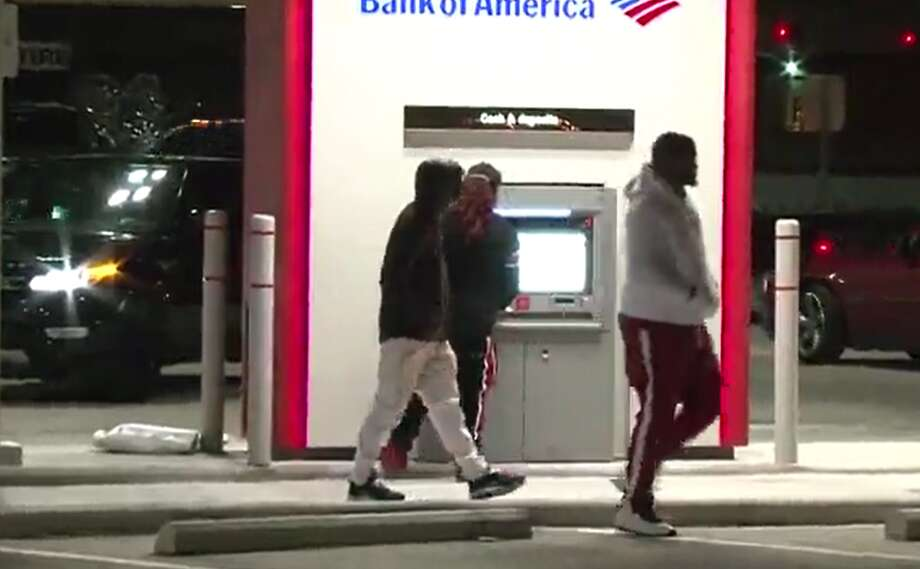A glitch at an ATM in north Harris County caused it to mistakenly dispense $100 bills. Photo: Metro Video