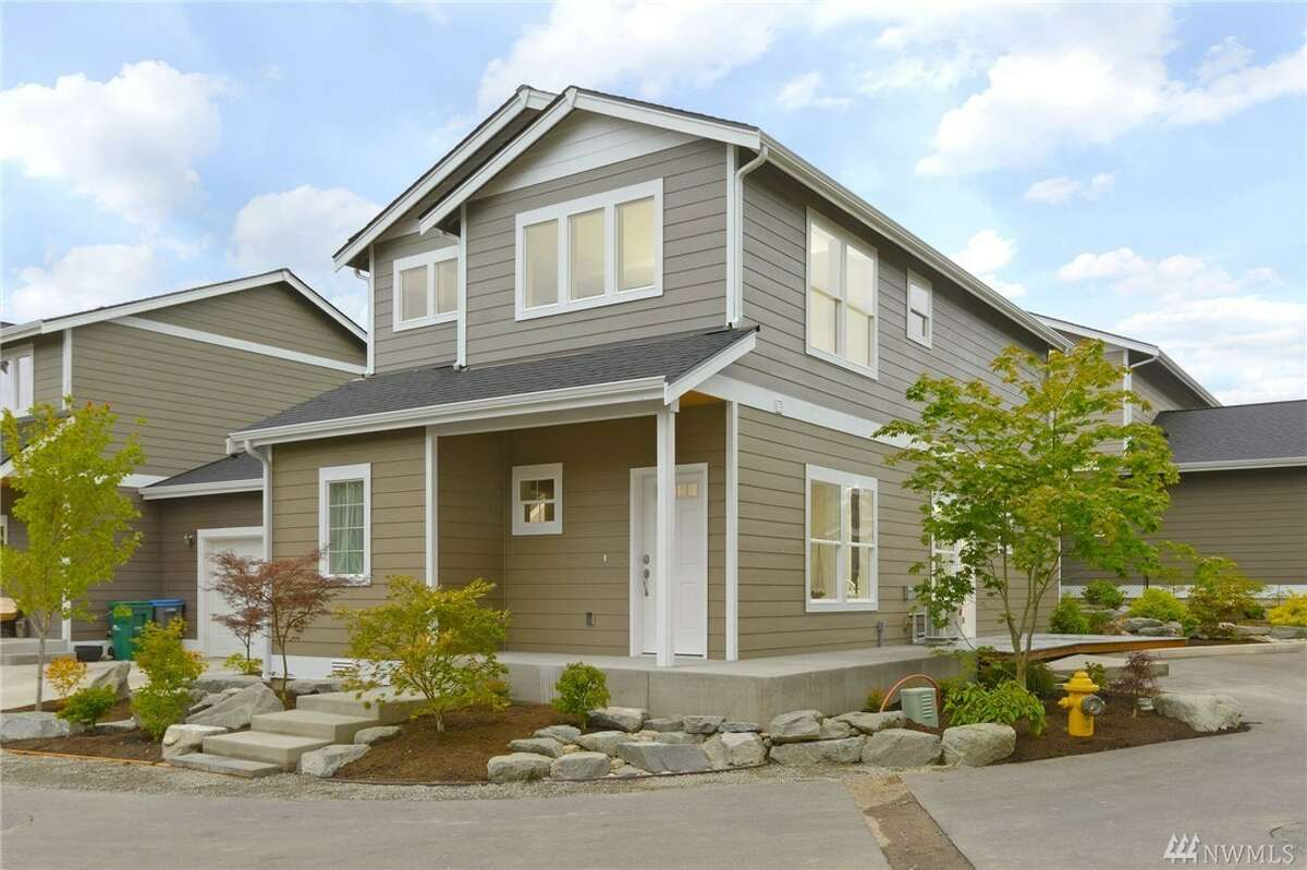 This newly constructed home is within walking distance to the town, beaches and ferries, and has two bedrooms plus a bonus room. From a welcoming porch to the easy-care deck, to the white trim and cabinetry, this home is inviting and cozy. 10783 N.E. Old Growth Lp., Lot 9, listed for $383,700. See the full listing here.