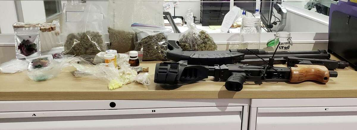 During a routine traffic stop, Harris County deputies retrieved an AK47 with two magazines, a 12 gauge shotgun, a pistol with one magazine; as well as a variety of drugs that include over four pounds of marijuana, 51 grams of Xanax, 26.4 grams of Ecstasy, three packages of marijuana gummy bears, 26 Adderall pills, 20.9 grams of Hashish, 20.2 grams of Hydrocodone pills and 26 Alaz36 pills.