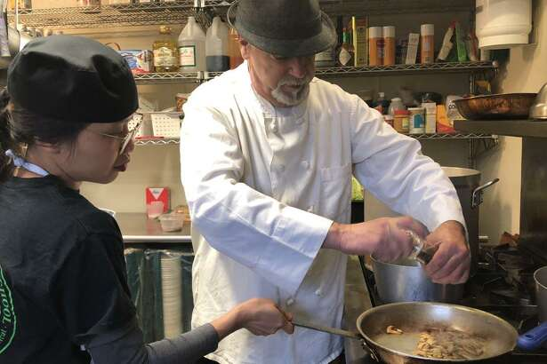 Chef Blythe Roberts has returned to head up the sessions at the Community Culinary School of Northwest Connecticut in New Milford. He is shown above with Anh Le of Kent, who came to the U.S. from Vietnam eight months ago, as she makes chicken marsala sauce.