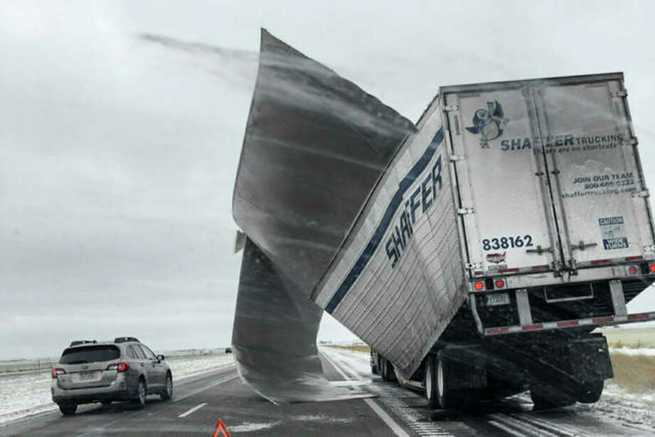 This Nov. 25, 2018 photo which was released by the Nebraska State Patrol, shows a broken up trailer amid blowing snow on Interstate 80 near Bradshaw, Neb. Blizzard-like conditions have closed highways and delayed air travel as a winter storm moved through the Midwest. Photo: Nebraska State Patrol Via AP