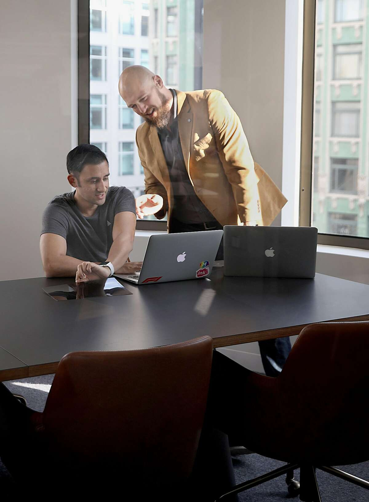 Account manager Jason Dhiman (left) and solutions architect Chris Kopyar (right) work in the new Movable Ink office spaceon Tuesday, Nov. 20, 2018, in San Francisco, Calif.