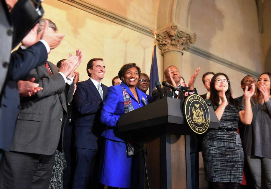 Senator Andrea Stewart-Cousins is cheered by fellow Senate Democrats after being named as state Senate majority leader on Monday, Nov. 26, 2018, at the Capitol in Albany, N.Y. She is the first female majority leader in either house of the state legislature. (Will Waldron/Times Union) Photo: Will Waldron, Albany Times Union / 20045564A