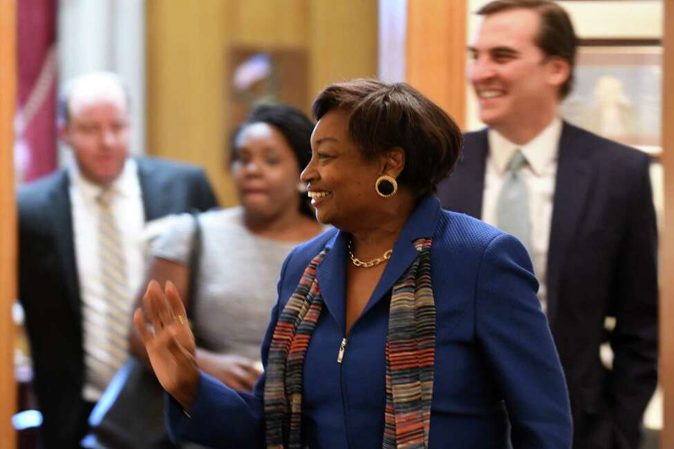 Senator Andrea Stewart-Cousins waves to a staffer as she leaves the state Senate Democratic offices with Sen. Michael Gianaris, her new deputy, right, after being named as state Senate majority leader on Monday, Nov. 26, 2018, at the Capitol in Albany, N.Y. She is the first female majority leader in either house of the state legislature. (Will Waldron/Times Union)
