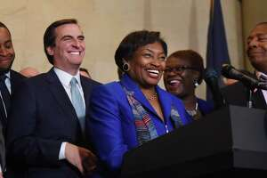 Senator Andrea Stewart-Cousins laughs with Sen. Michael Gianaris, her new deputy, left, after being named as state Senate majority leader on Monday, Nov. 26, 2018, during a press conference at the Capitol in Albany, N.Y. She is the first female majority leader in either house of the state legislature. (Will Waldron/Times Union)