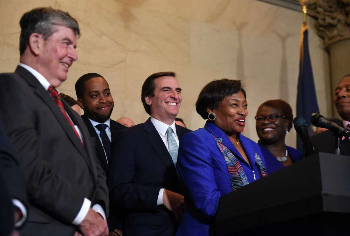 Sen. Neil Breslin, left, joins Senator Andrea Stewart-Cousins, center right, and Sen. Michael Gianaris, her new deputy, center left, during a press conference where Sen. Stewart-Cousins was announced as state Senate majority leader on Monday, Nov. 26, 2018, at the Capitol in Albany, N.Y. She is the first female majority leader in either house of the state legislature. (Will Waldron/Times Union)