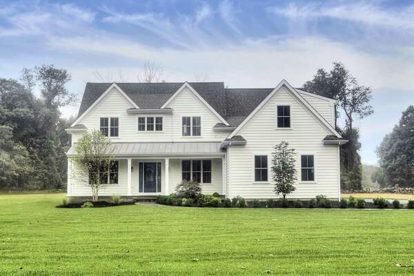 The newsly constructed colonial farmhouse at 1115 Banks North Road in the Greenfield Hills neighborhood features 10 rooms and 4,400 square feet of living space.