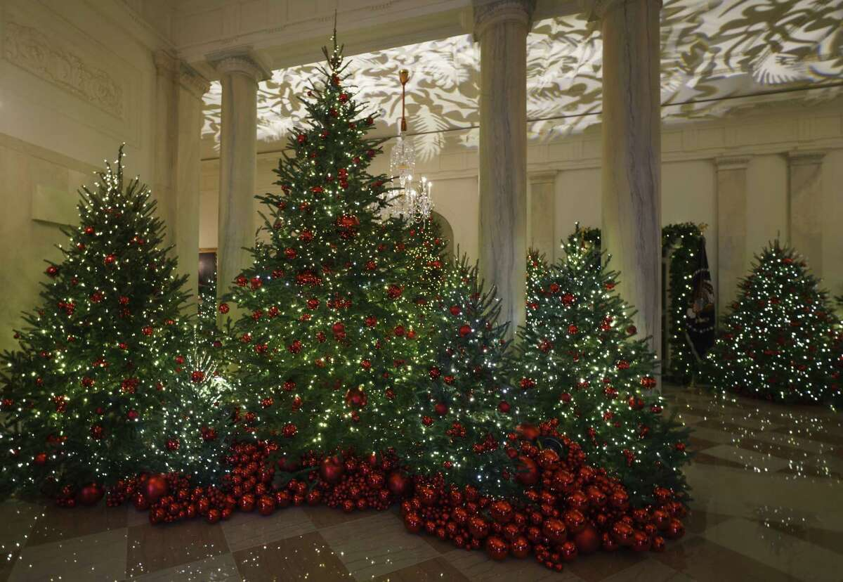 Grand Foyer and Cross Hall are seen during the 2018 Christmas preview at the White House in Washington, Monday, Nov. 26, 2018. Christmas has arrived at the White House for 2018 as first lady Melania Trump unveiled the holiday decor. She designed the decor, which features a theme of