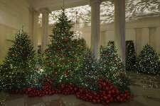 "Grand Foyer and Cross Hall are seen during the 2018 Christmas preview at the White House in Washington, Monday, Nov. 26, 2018. Christmas has arrived at the White House for 2018 as first lady Melania Trump unveiled the holiday decor. She designed the decor, which features a theme of ""American Treasures."" (AP Photo/Carolyn Kaster)"