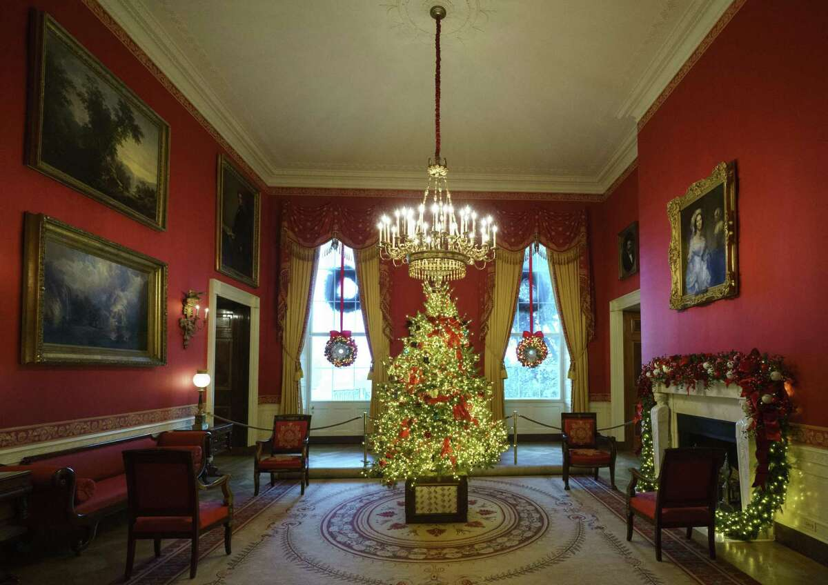 The Red Room, with the theme to celebrate America's Children, is seen during the 2018 Christmas Press Preview at the White House in Washington, Monday, Nov. 26, 2018. Christmas has arrived at the White House for 2018 as first lady Melania Trump unveiled the holiday decor. She designed the decor, which features a theme of