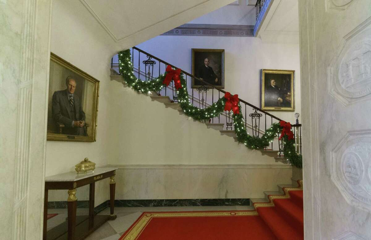 Garland decorates the Grand Staircase during the 2018 Christmas preview at the White House in Washington, Monday, Nov. 26, 2018. Christmas has arrived at the White House for 2018 as first lady Melania Trump unveiled the holiday decor. She designed the decor, which features a theme of