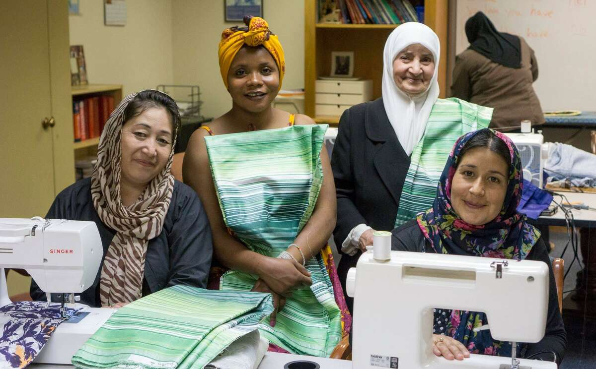 Refugee women from countries including Afghanistan, Congo, Syria are members of the IRIS Women's Sewing Group.