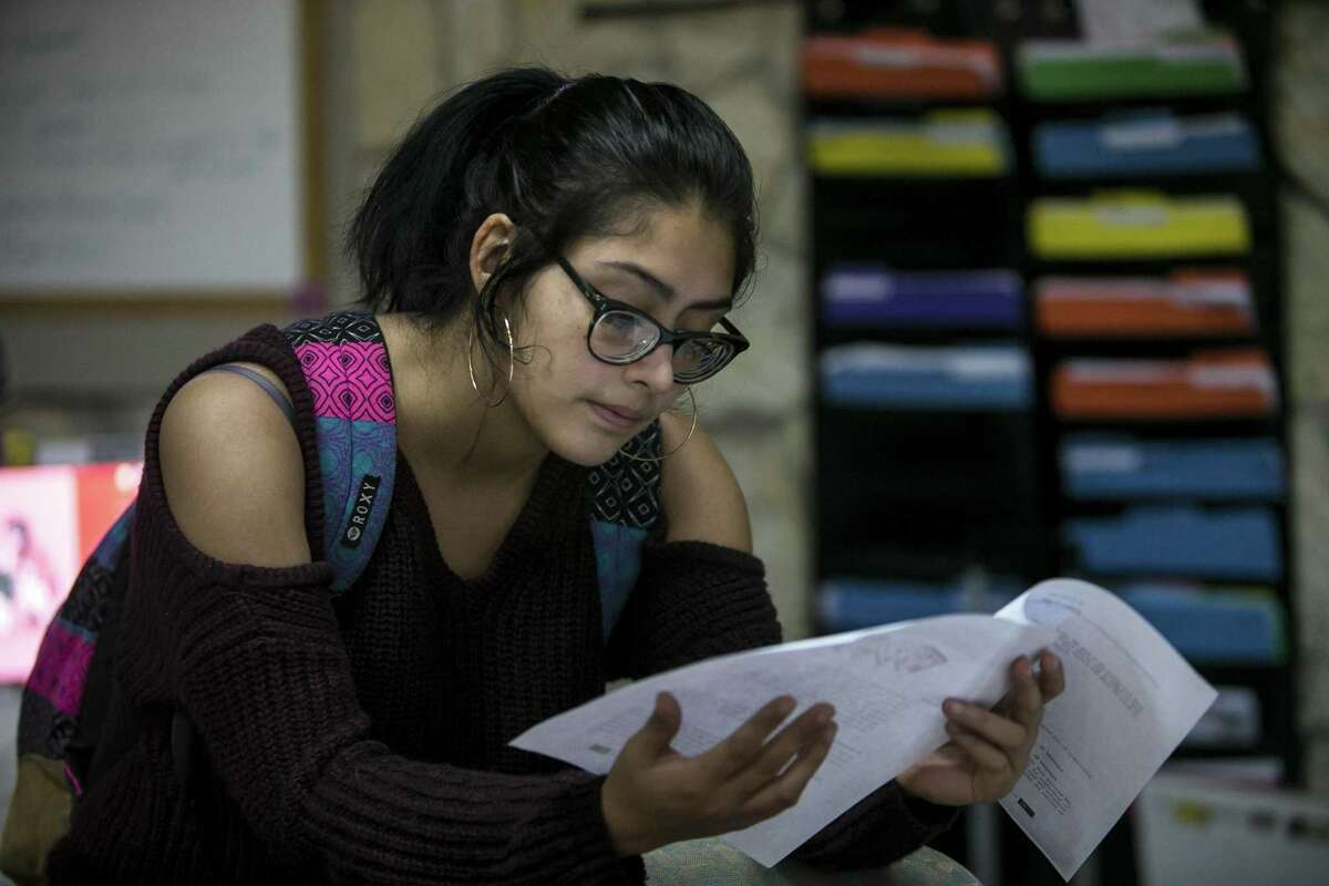 Myra Solis looks over an after school lesson plan at Martinez Street Women?•s Center, Thursday, Nov. 8, 2018. The center works to improve the community through encouraging positive development based on social justice principles; woman-led community health programming.