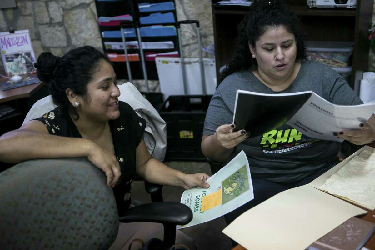 Madeline Sanibanez and Kim Bonoan work on lesson plans for upcomming after school programs at Martinez Street Women?•s Center, Thursday, Nov. 8, 2018. The center works to improve the community through encouraging positive development based on social justice principles; woman-led community health programming.