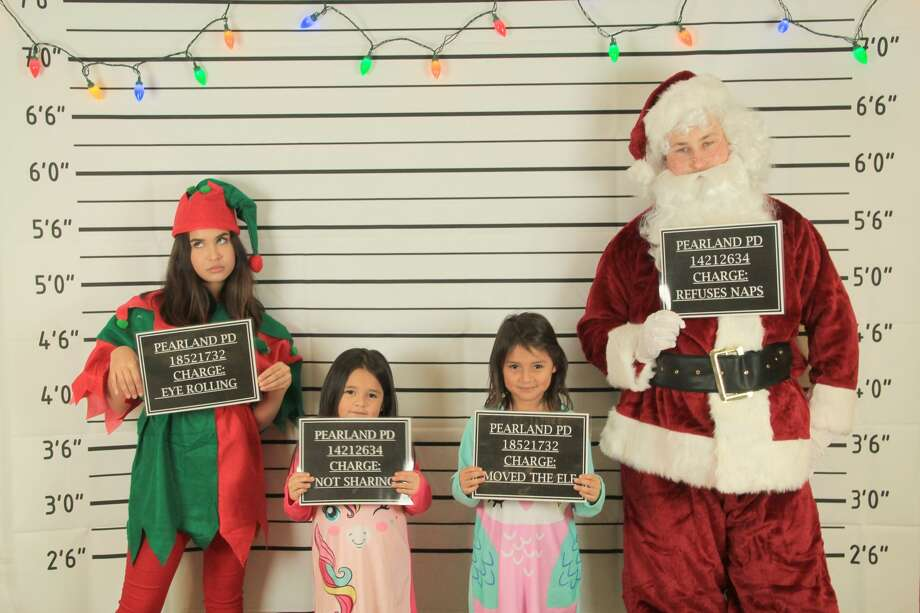 Houston area kids that have made Santa's naughty list this year can get their mugshot taken with Santa thanks to a Pearland Police Department youth training program fundraiser. Photo: Courtesy Pearland Police Explorers Post #237
