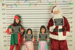 """But """"naughty"""" kids wanting to get a word in with Santa before the holidays will have the perfect chance to do so thanks to a new fundraising event hosted by a local youth police program. The Pearland Police Explorers Post #237 will host a """"Mug Shots with Santa"""" photo op event this Friday, Nov. 30."""