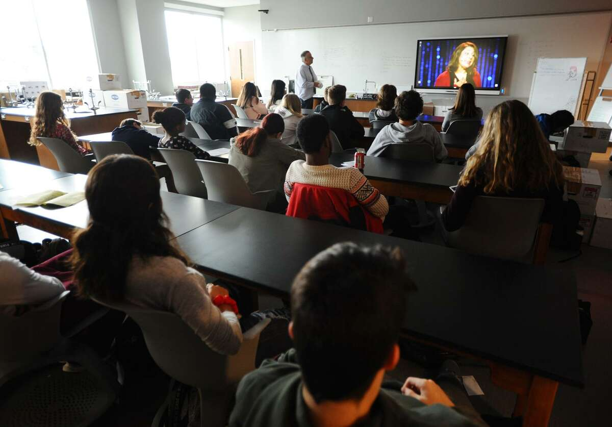 Students watch a TED talk during their first day of classes in the new Stratford High School in Stratford, Conn. on Monday, November 26, 2018.