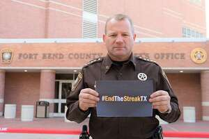 Fort Bend County Sheriff Troy Nehls shows his support for the Texas Department of Transportation's #EndTheStreakTX campaign.