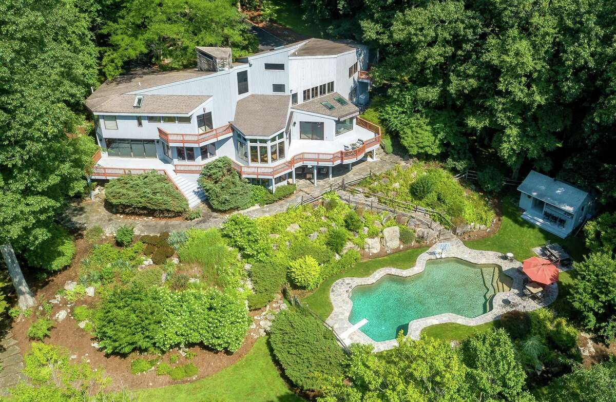 The home is nestled on 2.8 acres overlooking the Aspetuck River.