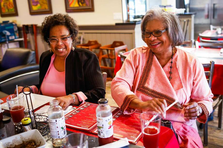 Dr. Frankie Moore (left) and the Rev. Barbara Galloway-Lee laugh as they dine at at Kendejah in San Leandro, the Bay Area's only Liberian restaurant. Photo: Gabrielle Lurie / The Chronicle