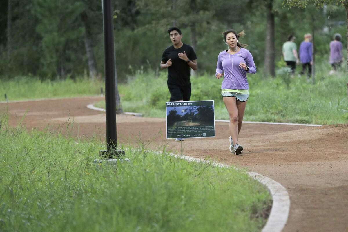 Runners push it on the trail of the Eastern Glades at Memorial Park.