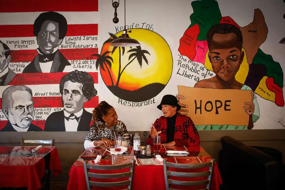 Diane Wade (left) and Jennifer Gibbs dine at Kendejah in San Leandro, the Bay Area's only Liberian restaurant. Photo: Gabrielle Lurie / The Chronicle