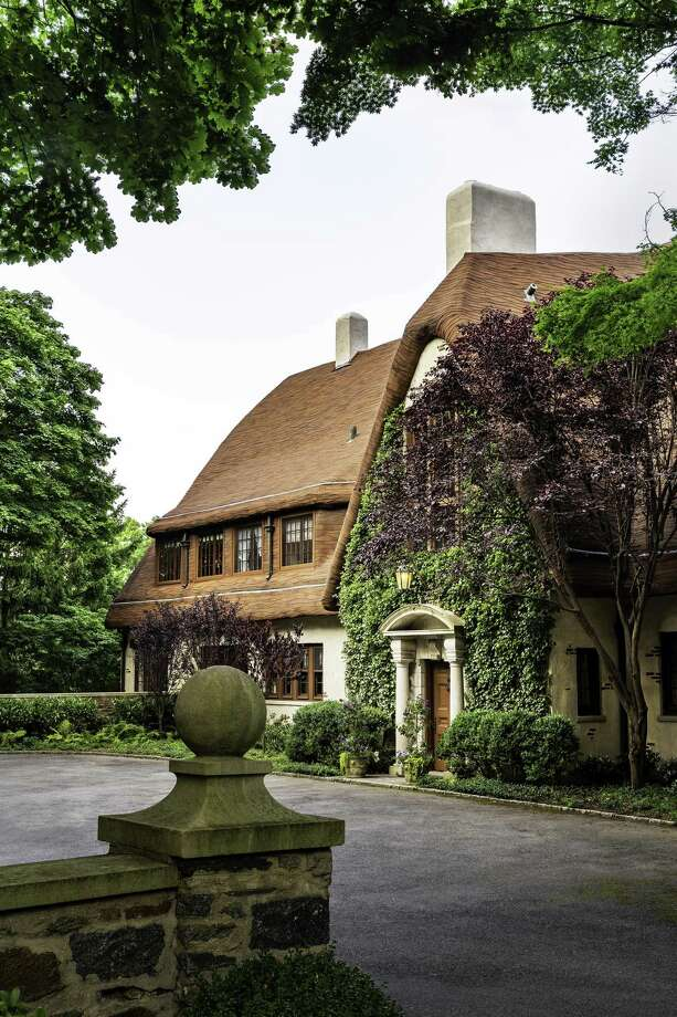 The Cotswold-style manor is on 2.4 acres in the Field Point Circle Association. The 1916 home is one of Greenwich's 27 Great Estates. Photo: The Robin Kencel Group, Compass / ONLINE_CHECK