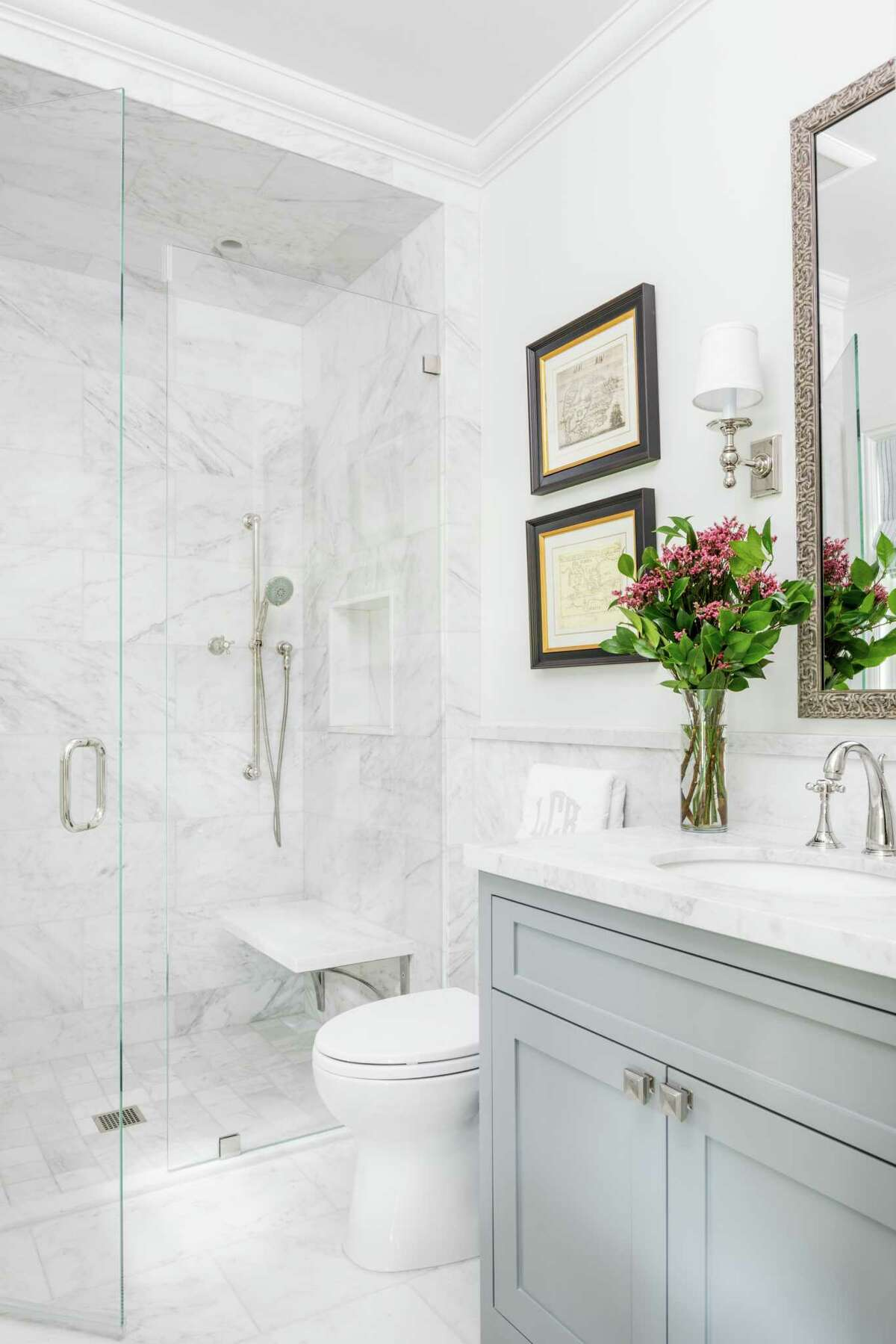 """As baby boomers remodel to age in place, they opt for """"no curb"""" or """"low curb"""" shower entries for easier access if they ever need to use a walker or wheelchair."""