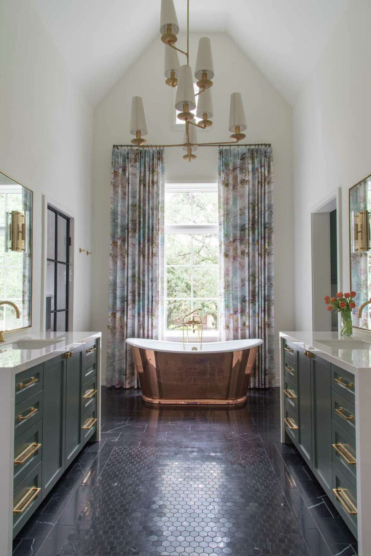 While a third of those remodeling choose to get rid of their master bathroom tub, those replacing it overwhelmingly choose a soaking tub, like this copper clad one.