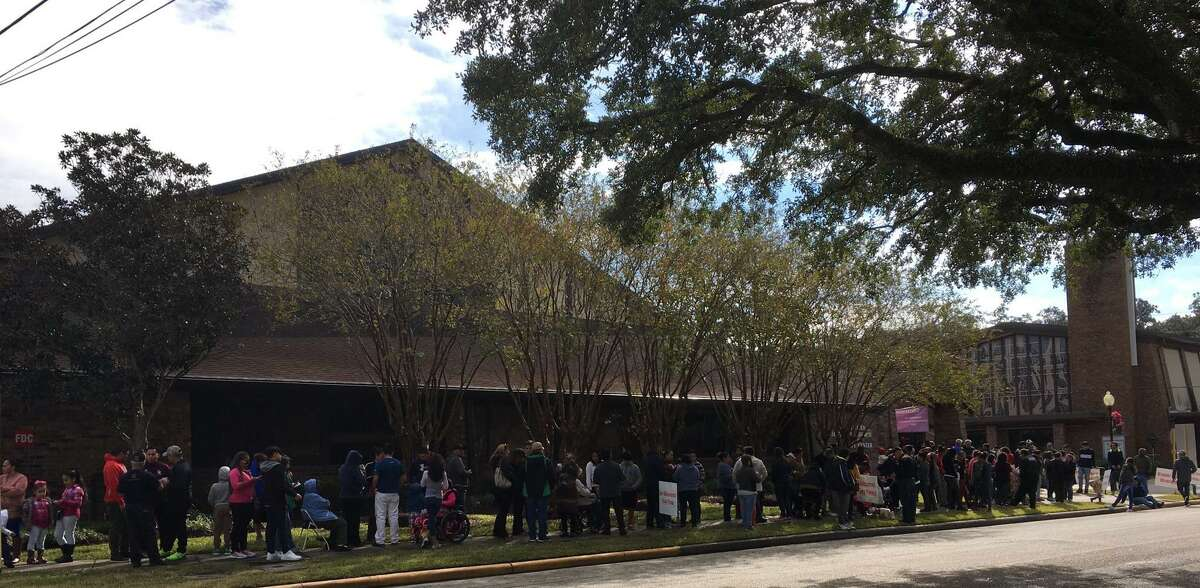 An hour before the start of the eighth annual Katy Thanksgiving Feast, a nearly block-long line of people had formed outside of the Family Life Center of Katy First United Methodist Church.