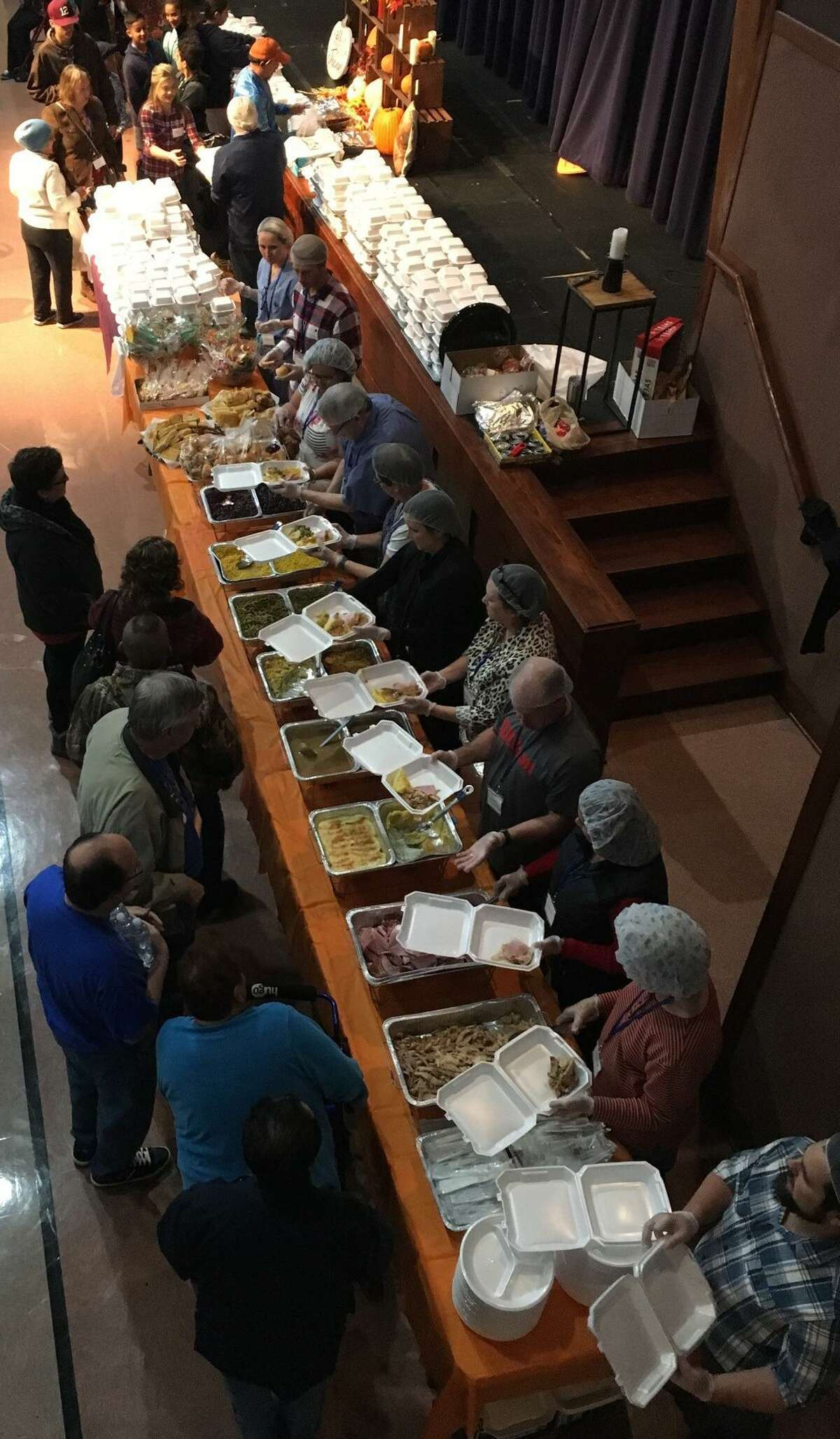 Church volunteers served food from two serving lines on Thanksgiving as part of the eighth annual Katy Thanksgiving Feast. Host church for this year's event was Katy First United Methodist Church.