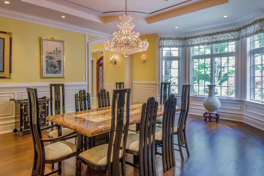 Located in the Byram Hills/Armonk school district – but with a Greenwich post office address – this 2013 custom-built European-inspired estate at 14 West Lane is listed for $7.25 million by Houlihan Lawrence. The formal dining room is but one of the many elegant interior spaces among the 10,801 square feet of living space. Photo: Houlihan Lawrence / ©Rob Schmidt 2018