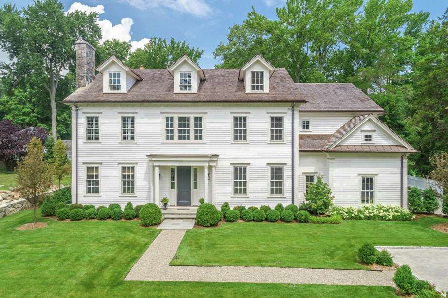 This in-town five-bedroom colonial was built in 2018 on a 0.41-acre lot. The floor plan includes four levels, including a third level with bonus space and a finished lower level with a 10-seat equipped bar. Photo: Sotheby's International Realty / ONLINE_CHECK