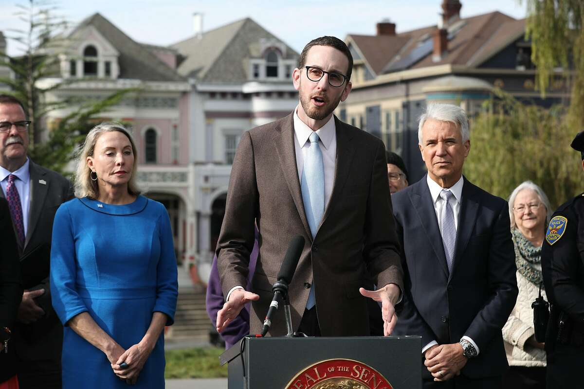 Senator Scott Weiner speaks during a press conference at Alamo Square Park about a new bill to close a loophole in prosecuting automobile break-ins on Monday, November 26, 2018 in San Francisco, Calif.