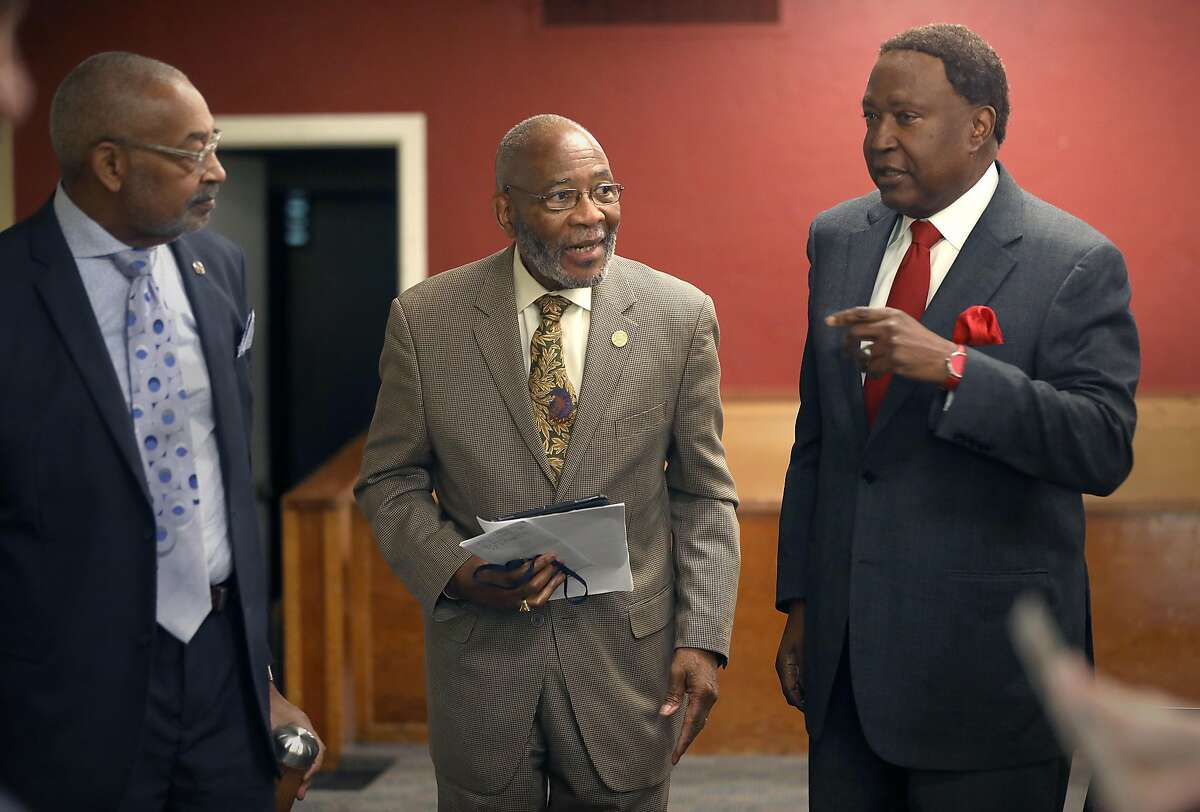Coastal Area director Dan Daniels of NAACP (left), Doctor Amos C. Brown (middle, chairman of Religious Affairs) and attorney John Burris (right) call for a boycott of the San Francisco Giants after majority owner Charles Johnson was found to have given a political donation to Cindy Hyde-Smith, a U.S. Senate candidate in Mississippi who made comments in support of public lynchings at Third Baptist Church on Monday, Nov. 26, 2018, in San Francisco, Calif.