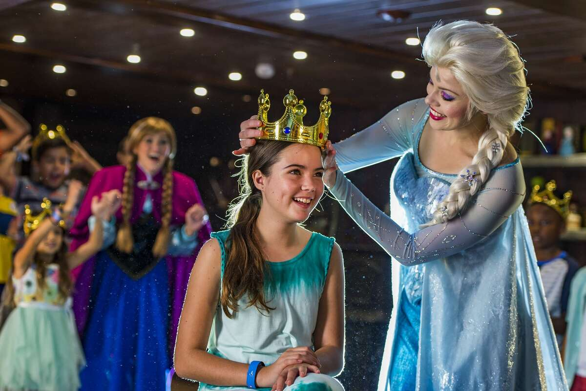 Guests prepare a special coronation for the royal sisters of Arendelle, and then receive a truly royal welcome themselves as Anna and Elsa visit the Oceaneer Club and Oceaneer Lab. (Matt Stroshane, photographer)